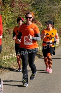around mile 9, the two ladies behind me also have flowers on, they passed me after a bit!