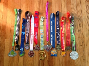 all 13 half marathon medals, look at all that bling!